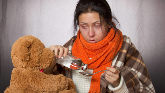 בחורה חולה בשפעת החזירים